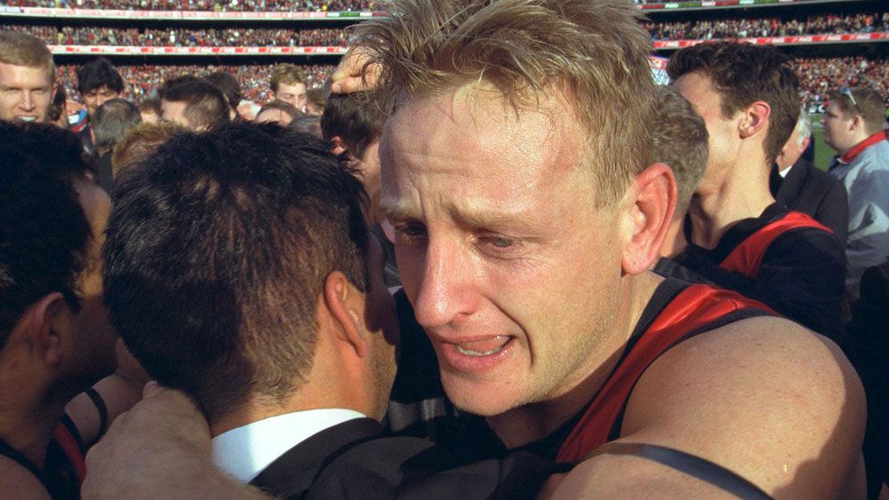 Essendon flag winner heads concussion suit