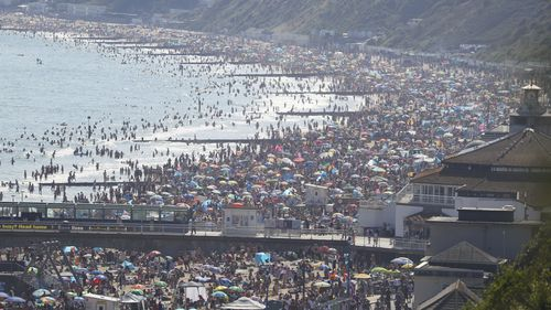 People are seen on Bourenmouth beach on the hottest day of the year.
