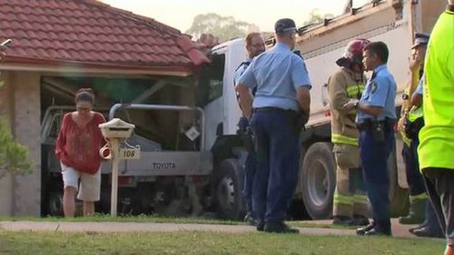 The truck pushed Mr Atwood's ute into the garage before colliding with a brick pillar.