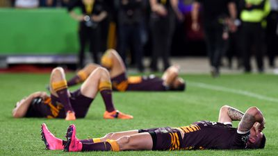 Meanwhile, the Broncos players commiserated on the field. (AAP)