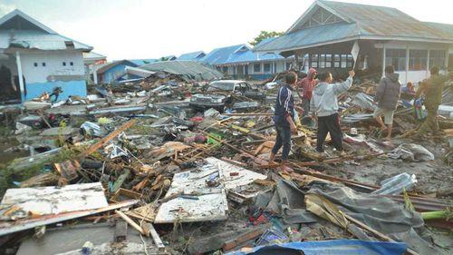 Locals survey the damage.
