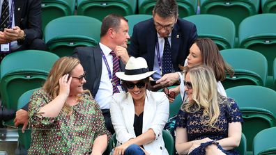 Duchess of Sussex watching Serena Williams on court one.