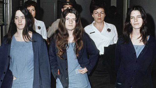 Susan Atkins, Patricia Krenwinkel and Leslie Van Houten are marched to court in 1971, sporting X-shaped scars on their foreheads. (AAP)