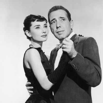 <p>Humphrey Bogart and Audrey Hepburn in <em>Sabrina</em> </p><p><strong>Age gap:</strong> 19 years, 8 months</p>