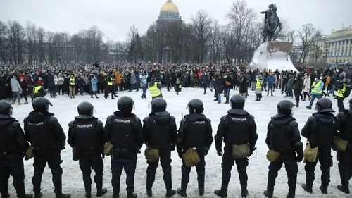 Police stand guard during a protest against the jailing of opposition leader Alexei Navalny in St. Petersburg, Russia, Saturday, Jan. 23, 2021