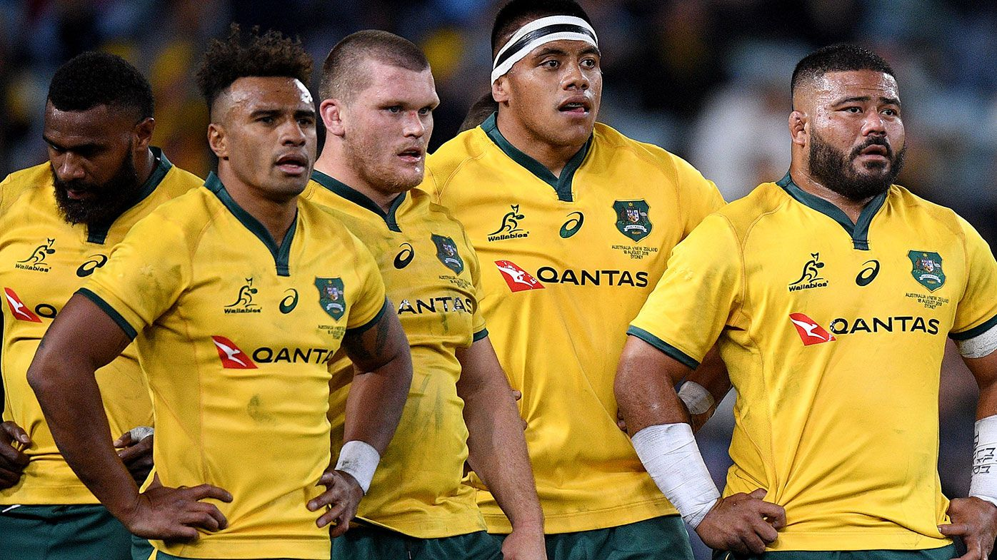 Wallabies players watch on after conceding a try during the opening Bledisloe Cup match against New Zealand
