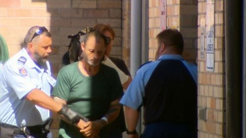 Anthony Sampieri is led to Maroubra Police Station today. (9News)