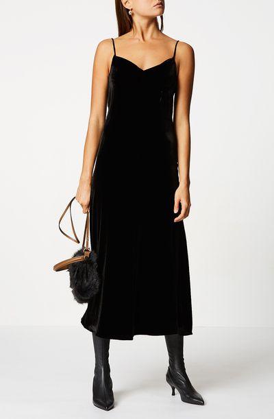 "<a href=""https://www.scanlantheodore.com/products/velvet-bias-slip-dress"" target=""_blank"">Scanlan Theodore Velvet Bias Slip Dress in Black, $360</a>"