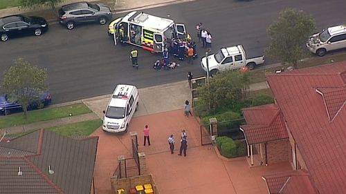 Paramedics have rushed to a premise in Sydney's west following reports a toddler has been injured in an accident involving a roller door.