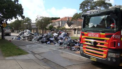 Fire and Rescue NSW quench a fire on a garbage truck. (9NEWS)