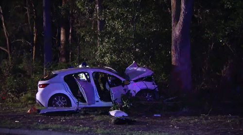 Two passengers were killed in a a car crash this morning when the vehicle ran off the road and into a tree at Salamander Bay in the NSW Hunter region. Picture: 9NEWS.