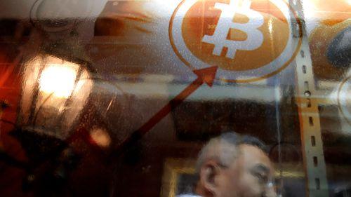 A man uses a Bitcoin ATM in Hong Kong.