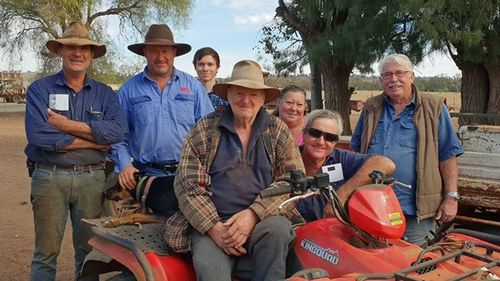 Les and Laura Jones (centre right) with Aussie Helpers founder Brian Egan (right)