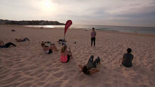 Early morning exercise at Bondi as temperatures climbed just after dawn.