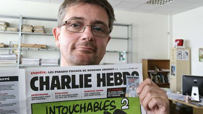 "The 47-year-old editor-in-chief of Charlie Hebdo, Stephane ""Charb"" Charbonnier, also one of its cartoonists, was among those killed. He had been assigned police bodyguards for the past three years. The newspaper lost three other cartoonists in the attack. (AAP)"