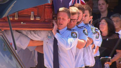 Today, his tearful colleagues from the NSW Police Force Academy carried his coffin into the church.