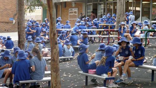 Sydney school welcomes teacher with hearing disability by introducing 'silent cheers' policy