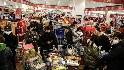 Wuhan residents shopping in a market in January this year.