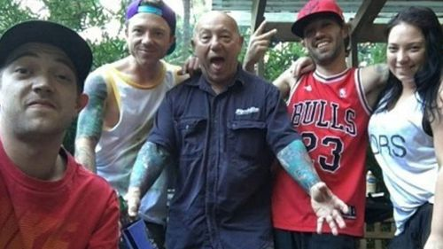 Angry Anderson, centre, with son Liam, left.