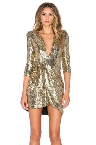 "<a href=""http://www.revolveclothing.com.au/zhivago-sovereign-of-stars-wrap-dress-in-gold/dp/ZHIR-WD1/"" target=""_blank"" draggable=""false"">Revolve dress, Soverign Stars of Wrap Dress</a>, $566.44."