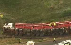 Road train rolls, driver killed in truck collision in WA