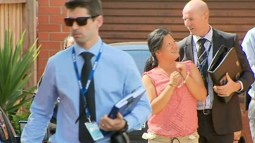 Amy Tran (in pink) smiled after being arrested over the bashing of a 77-year-old woman.