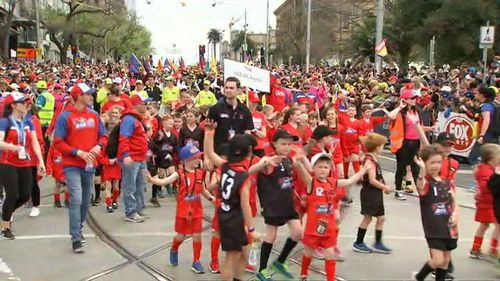 Thousands have taken to the streets of Melbourne today ahead of the final, marching to the MCG.