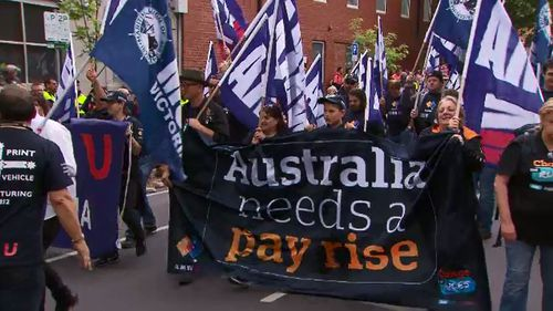Protestors called on the government to do more for workers' rights.