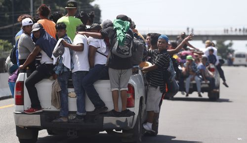On Sunday the caravan of thousands of mostly Honduran migrants crowded into the Mexican border city of Tapachula, setting up impromptu camps in public spaces under a heavy rain.