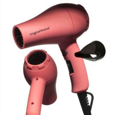 "<a href=""https://www.adorebeauty.com.au/o-m-original-mineral/o-m-pink-mini-travel-hair-dryers.html"" target=""_blank"">Original Mineral Mini Hairdryer, $49.95.<br> </a>"