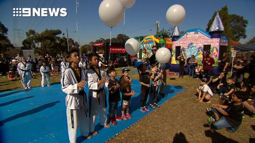 Martial arts students released the white balloons to symbolise each year of Julian's short life. (9NEWS)