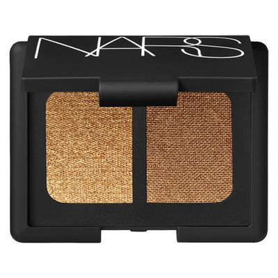 "<p><strong><em>Golden Eye</em></strong></p> <p><a href=""https://www.mecca.com.au/nars/eyeshadow-duo/V-000373.html"" target=""_blank"" draggable=""false"">NARS Eyeshadow Duo in Isolde, $52</a></p>"