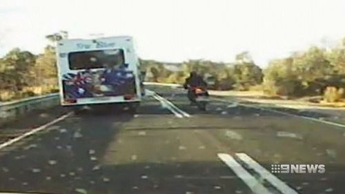 On the stretch of road at Kersbrook, the rider is seen crossing two solid white lines to overtake a vehicle. (9NEWS)