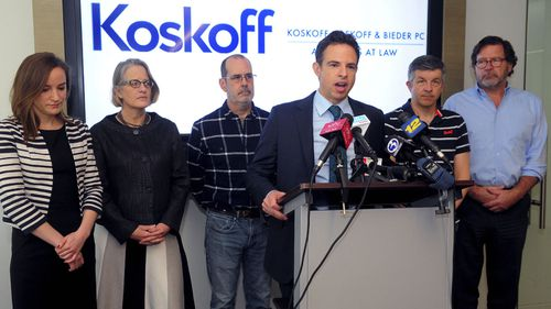 Attorney Josh Koskoff alongside families of Sandy Hook victims.