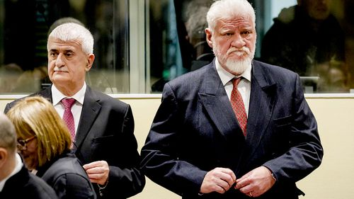 Bruno Stojic and Slobodan Praljak enter the Yugoslav War Crimes Tribunal in The Hague. (AAP)