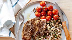 Lamb forequarter chops with roasted tomatoes and white bean salad