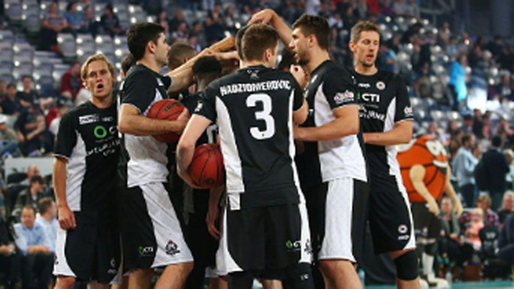Melbourne United players celebrate. (Getty)