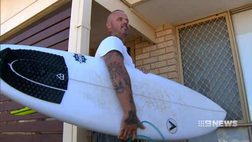 The encounter was enough to get surfer Adam Murray rushing back to shore. (9NEWS)