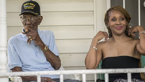 Richard Overton, left, smokes a cigar with friend Donna Shorts