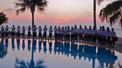 Kuredu Maldives staff lined up by the pool