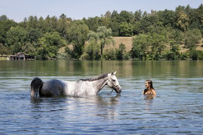 Shannon and her horse cool down in the Katzensee Lake in Zurich, Switzerland.