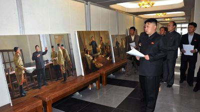 Kim Jong-Un inspect the creation of the works portraying late President Kim Il Sung to be displayed in the Victorious Fatherland Liberation War Museum (Getty).