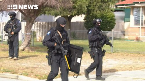 This afternoon heavily-armed officers surrounded a property on Wingrove Road in Langford.