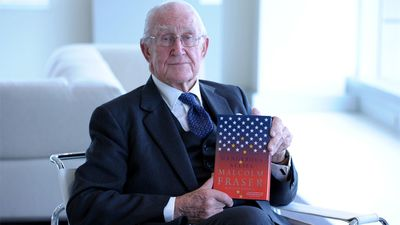 Malcolm Fraser signs copies of his new book Dangerous Allies in Melbourne, Tuesday, May 6. 2014. (AAP)