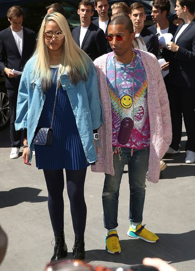Chanel handbag fan Pharrell Williams and Helen Lasichanh at the Chanel haute couture show, Paris.