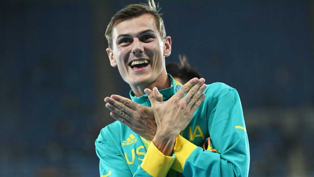 Bronze medallist Australia's Dane Bird-Smith celebrates on the podium for the Men's 20km Race Walk at the Rio 2016 Olympic Games at the Olympic Stadium in Rio de Janeiro on August 12, 2016. (AFP)