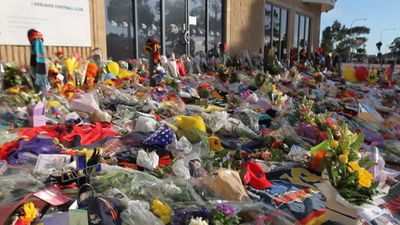 The sea of flowers outside Adelaide Crows HQ. (9NEWS)