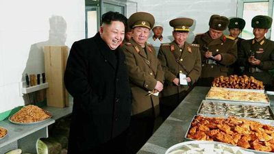 <p><b>Kim Jong Un: Comedian</b></p>And just because it's funny, Kim Jong Un is pictured laughing at fried chicken. (AP)