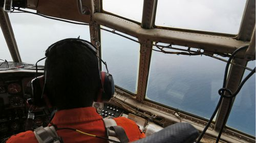A crew of an Indonesian Air Force C-130 airplane of the 31st Air Squadron scans the horizon for the missing jet. (AAP)