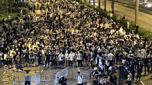 Hong Kong citizens march through the streets in a massive protest against China's extradition law.